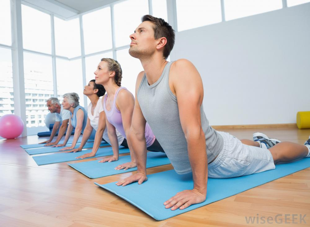 group-of-people-on-blue-mats-doing-yoga