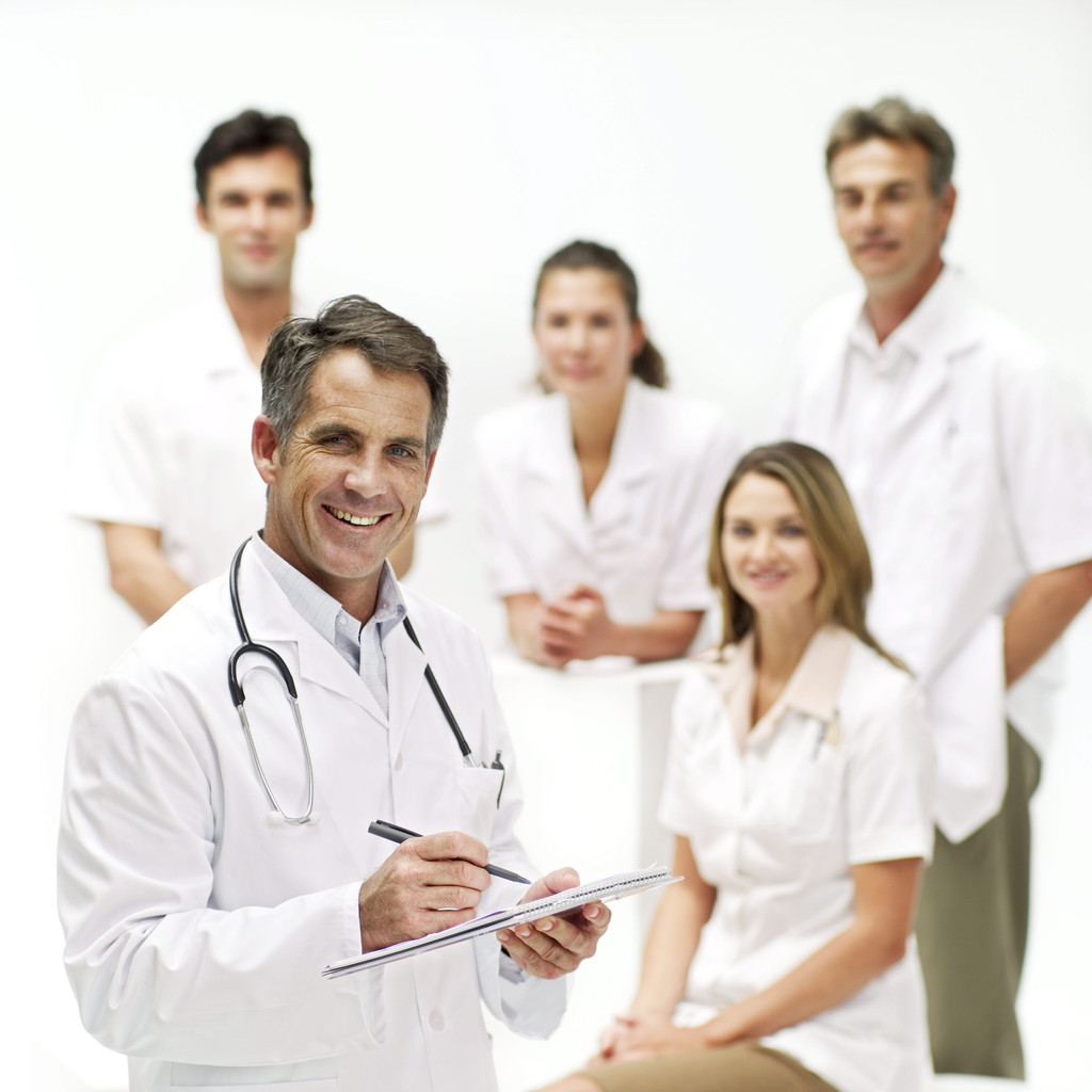 Young Doctors Smiling --- Image by © Royalty-Free/Corbis