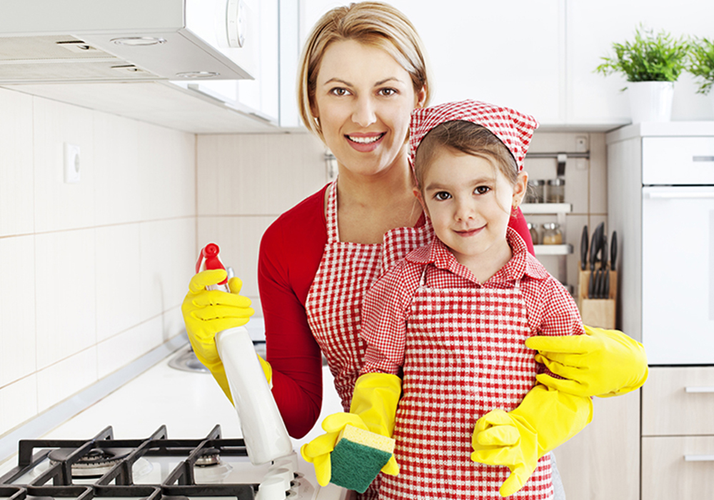 Mother and daughter cleaning the kitchen together